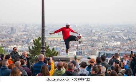 Paris, France - November 23, 2014: Footballer freestyler, Iya Traore from Guinea, in Sacre Couer Basilica, Montmartre.