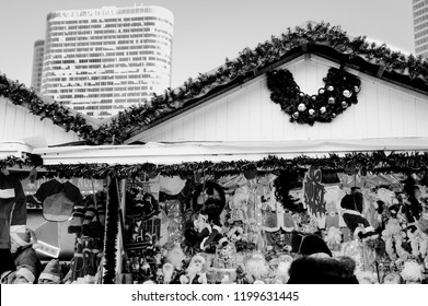PARIS, FRANCE - NOVEMBER 25, 2017: Woman choosing souvenirs at Christmas market in La Defense. La Defense is a major business district of Paris and largest open-air contemporary art gallery in France.