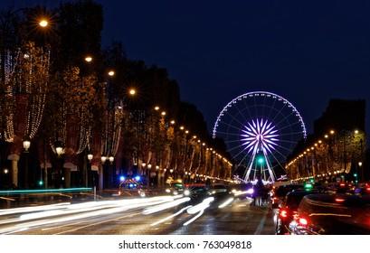 Paris, France - November 25, 2017: Christmas time, the decoration along the Avenue des Champs Elysees and Ferris wheel