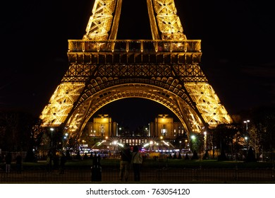 PARIS - FRANCE, NOVEMBER 25, 2017: Eiffel Tower brightly illuminated at night in Paris. The Eiffel tower is the most visited monument of France