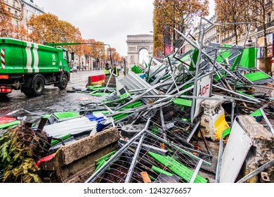 PARIS, FRANCE - November 25, 2018. The Avenue des Champs Elysés the day after demonstrations of yellow vests. Barricades erected by the demonstrators to block the police.