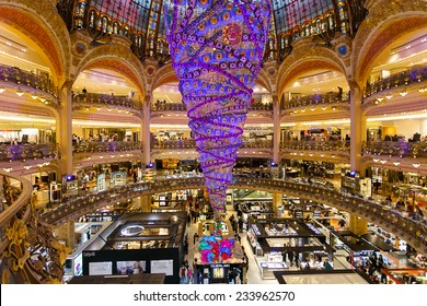 Paris, France - November 26, 2014: The Galeries Lafayette with the Christmas decorations and the upside down tree. The special Christmas Tree is the largest indoor world.