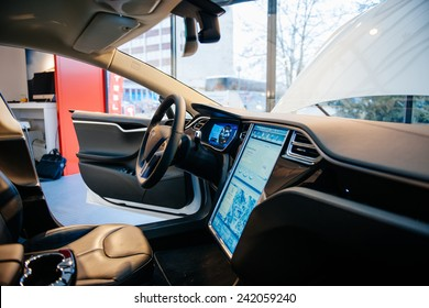 PARIS, FRANCE - NOVEMBER 29, 2014: The interior of a Tesla Motors Inc. Model S electric vehicle with its large touchscreen dashboard.