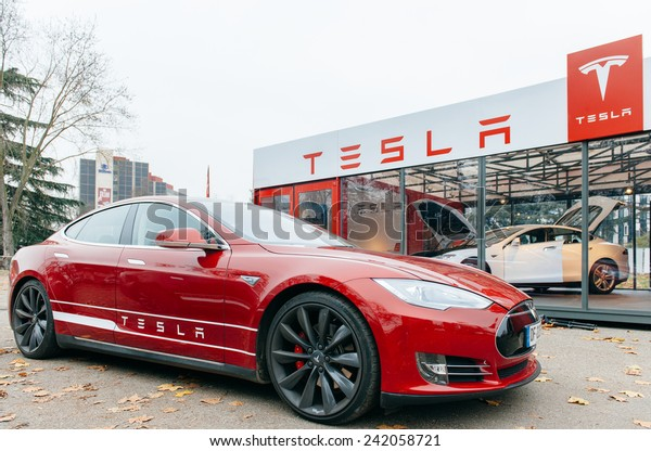PARIS, FRANCE - NOVEMBER 29, 2014: New Tesla Model S showroom has arrived in Paris, France. Tesla is an American company that designs, manufactures, and sells electric cars