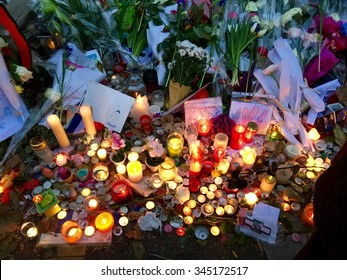 PARIS, FRANCE - NOVEMBER 29, 2015: Illuminated candles at the memorial tribute to the victims of the  terrorist attack by Isis at the Theatre Le Bataclan on November 13, 2015 in Paris, France.