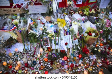 PARIS, FRANCE - NOVEMBER 29, 2015: Flowers and candles line the street in front of   the Theater Le Bataclan for the victims of the November 13, 2015 terrorist attack in Paris, France.