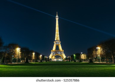 PARIS, FRANCE - NOVEMBER 29, 2016: The Eiffel Tower (Tour Eiffel) illuminated at dusk. It's a wrought iron lattice tower named after the engineer Gustave Eiffel.