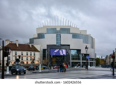 Paris / France — November 3, 2019: modern glass facade of the new Opera Bastille. Bastille Opera House is a main facility of Paris National Opera. The theater is used for ballet and opera performances