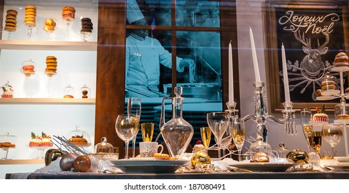 PARIS, FRANCE - NOVEMBER 30, 2013: Christmas decoration in windows of BHV department store and reflection of Hotel de Ville (City Hall). Christmas shopping in Paris starts already in November.