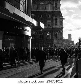 PARIS, FRANCE - NOVEMBER 30, 2013: Shopping crowd near BHV department store located across Hotel de Ville (City Hall). Christmas shopping in Paris starts already in November.