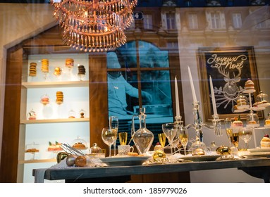 PARIS, FRANCE - NOVEMBER 30: Christmas decoration in windows of BHV department store and reflection of Hotel de Ville (City Hall). Christmas shopping in Paris starts already in November.