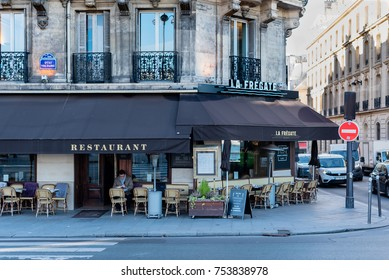 Paris, France -- November 7, 2017 -- A man is sitting in a Parisian sidewalk cafe having a cup of coffee.  Editorial Use Only.