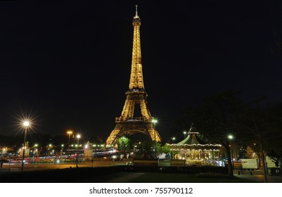 PARIS - FRANCE, NOVEMBER 7, 2017: Eiffel Tower brightly illuminated at dusk in Paris. The Eiffel tower is the most visited monument of France
