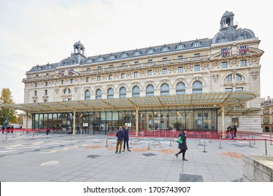PARIS, FRANCE - NOVEMBER 8, 2019: Gare D'Orsay or Orsay museum building with people in a cloudy morning in Paris