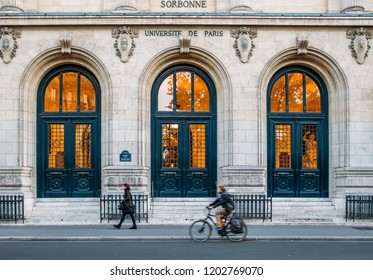 Paris, France - Oct 13, 2018: Pedestrian and cyclist with outside facade of the pretigious University Sorbonne in Paris, France