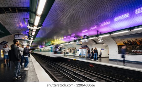 PARIS, FRANCE - OCT 13, 2018: Commuters large crowd of people waiting in the Montparnasse  train commuting in the metropolitain of paris perspective view security of public space - wide image