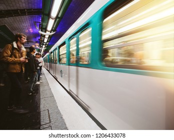 PARIS, FRANCE - OCT 13, 2018: Train subway metro arrival departure at Montparnasse bienvenue metro subway station people commuting in the metropolitain of paris perspective view