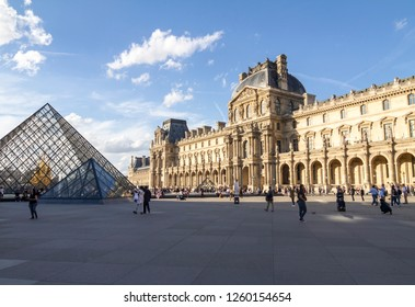 PARIS, FRANCE - Oct 13, 2018: View of famous Louvre Museum with Louvre Pyramid at evening. Louvre Museum is one of the largest and most visited museums worldwide