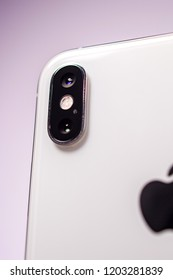 PARIS, FRANCE - OCT 2, 2018: New dual camera as hero object on bright glamorous Apple iphone Xs Max