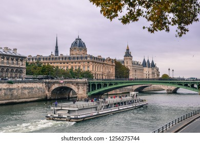 Paris, France - Oct 2, 2018. Touristic ferry sailing down the Seine of Paris, France. Paris was ranked as the third most visited travel destination in the world in 2017.