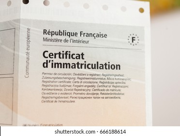 PARIS, FRANCE - OCT 26, 2016: Detail of the vehicle registration certificate (certificat d'immatriculation known also as carte grise) issued by the Ministry of Interior of France.
