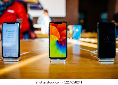 PARIS, FRANCE - OCT 26, 2018: New iPhone XR smartphone in Apple Store Computers during the launch day with screensaver on Liquid Retina display LCD