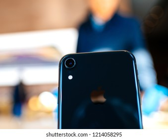 PARIS, FRANCE - OCT 26, 2018: Closeup of the new Apple iPhone XR smartphone in Apple Store Computers during the launch day