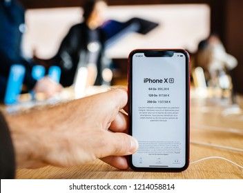 PARIS, FRANCE - OCT 26, 2018: Latest iPhone XR smartphone in Apple Store Computers during the launch day with all prices for 64, 128, 256 GB storage option prices are in euros