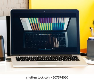 PARIS, FRANCE - OCT 28 2016: Apple Computers website on new MacBook Pro Retina with OLED Touch bar in creative room showcasing Apple Keynote presentation of Jhony Ive presenting the new laptop film
