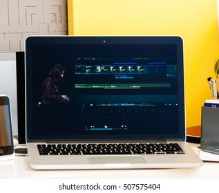 PARIS, FRANCE - OCT 28 2016: Apple Computers website on new MacBook Pro Retina with OLED Touch bar in geek creative room showcasing Apple Keynote presentation of OLE and Final Cut Pro software