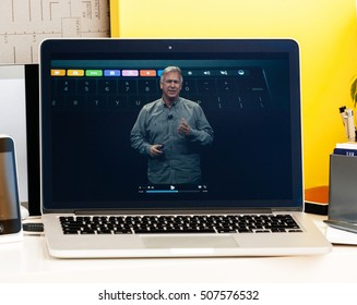 PARIS, FRANCE - OCT 28 2016: Apple Computers website on new MacBook Pro Retina with OLED Touch bar in geek room Apple Keynote presentation of philip Schiller talking about oled bar integration