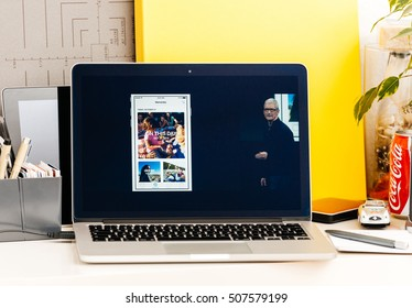PARIS, FRANCE - OCT 28 2016: Apple Computers website on new MacBook Pro Retina with OLED Touch bar in geek creative room showcasing Apple Keynote presentation of Memories on Photo app iPhone 7