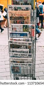 PARIS, FRANCE - OCT 28, 2017: International Newspapers featuring election of Angela Merkel in Germany, Financial Times, Bild, Die Zeit, Die Welt, Frankfurter Allgemeine,