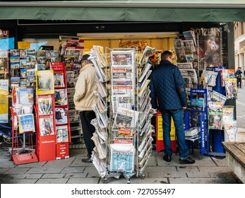 PARIS, FRANCE - OCT 3, 2017: People Seniors buying international newspapers at kiosk with socking title photos at about the 2017 Las Vegas Strip shooting United States 60 fatalities and 527 injuries