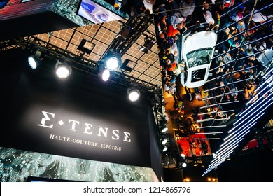 PARIS, FRANCE - OCT 4, 2018: E-Tense Haute-Couture electric logo with French Citroen DS 3 Crossback e-Tense electric car reflected on roof - exhibition stand