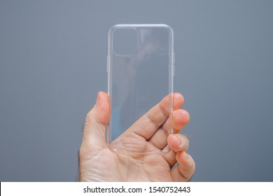 Paris, France - Oct 4, 2019: Man hand holding new unboxed Apple Computers iPhone 11 pro Clear case for the latest smartphone