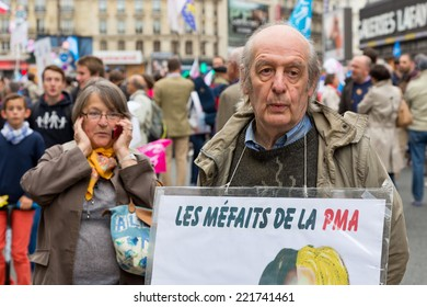 "PARIS, FRANCE - OCT. 5, 2014: A man holds a sign that says ""what's bad about IVF"" during an anti-gay rights protest in Paris. The manifestation drew around 100,000 people that day."