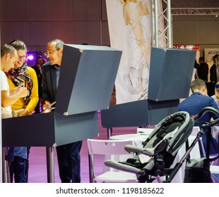 PARIS, FRANCE - OCT 6, 2018: Wedding Exhibition Paris 2018 with people - customers and exhibitions talking about wedding rings at booth