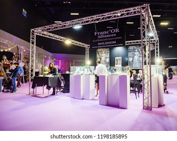 PARIS, FRANCE - OCT 6, 2018: Wedding Exhibition Paris 2018 with people - customers and exhibitions preparing for the marriage event booth selling jewelry and wedding rings