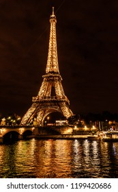 PARIS, FRANCE, October 01, 2018: Paris Champ de Mars with the famous Eiffel Tower in the night. Eiffel Tower is tallest structure in Paris and most visited monument in the world. Color filters
