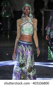 PARIS, FRANCE - OCTOBER 01: A model walks the runway during the Manish Arora show as part of the Paris Fashion Week Womenswear Spring/Summer 2016 on October 1, 2015 in Paris, France.