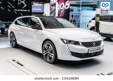 Paris, France, October 02, 2018: metallic white electric plug in all new Peugeot 508 SW Hybrid Station Wagon Combi at Mondial Paris Motor Show, car produced by Peugeot