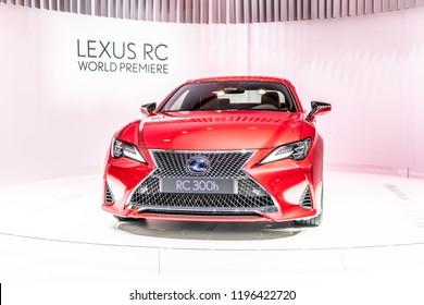 Paris, France, October 02, 2018: metallic red LEXUS RC 300h hybrid ENGINEERED FOR PURE ENJOYMENT at Mondial Paris Motor Show, produced by Japanese car maker Lexus