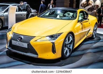 Paris, France, October 02, 2018: metallic yellow LEXUS LC 500h hybrid LUXURY COUPE EXHILARATING DRIVE at Mondial Paris Motor Show, produced by Japanese car maker Lexus