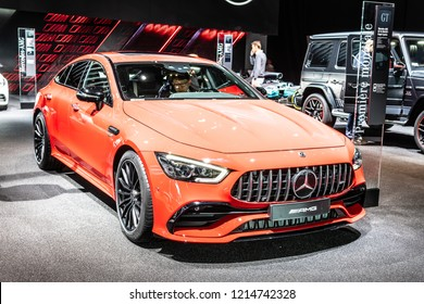 Paris, France, October 02, 2018: World premiere: metallic red Mercedes-AMG GT 43 4MATIC+ Coupe 4 doors at Mondial Paris Motor Show, produced by Mercedes Benz