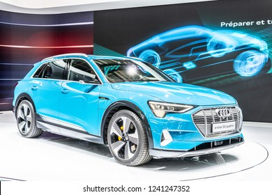Paris, France, October 02, 2018: metallic blue electric Audi e-tron 55 quattro SUV with high voltage battery and electric engine motor at Mondial Paris Motor Show, produced by Audi AG