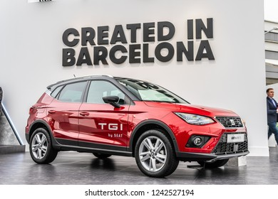 Paris, France, October 02, 2018: metallic red Seat New Arona FR TGI CNG at Mondial Paris Motor Show, produced by Spanish automobile manufacturer SEAT