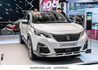Paris, France, October 02, 2018: metallic white new electric plug in Peugeot 3008 Hybrid4 at Mondial Paris Motor Show, car produced by Peugeot