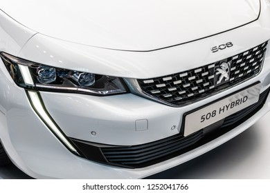 Paris, France, October 02, 2018: metallic white electric plug in all new Peugeot 508 Hybrid at Mondial Paris Motor Show, car produced by Peugeot
