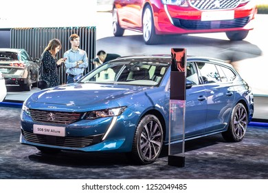 Paris, France, October 02, 2018: metallic blue all new Peugeot 508 SW Allure Station Wagon Combi at Mondial Paris Motor Show, car produced by Peugeot